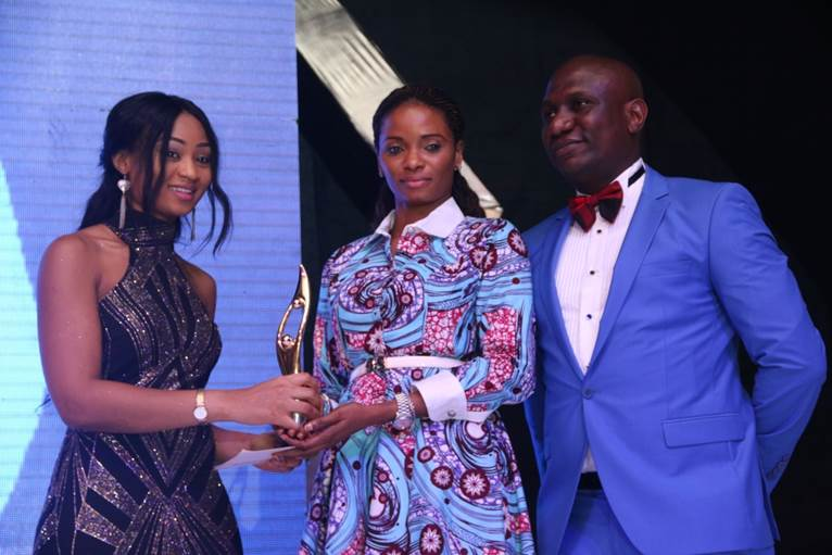 Pix 2: Thelma Chukwu of Nestoil presenting award for best company in CSR Sustainability, West Africa to Ijeoma Aso, Managing Director, UBA Foundation while Olusegun Fafore, Corporate Communications Manager, Nest Oil,  looks on...at the 2016 SERAS CSR Awards -Africa in Lagos, during the weekend.